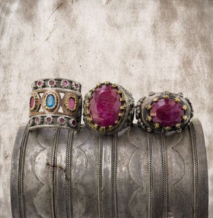 ruby gemstone: three ottoman style vintage rings on a grunge silver bracelet.