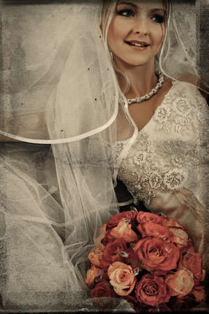 beautiful bride with large veil and silk wedding dress on grunge background with texture detail