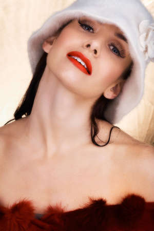 beautiful woman with red lips and long false eyelashes smiling with confidence photo
