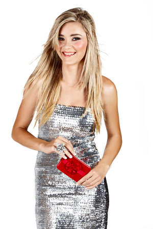 beautiful smiling blond woman in silver minidress holding red gift box isoltaed on white photo