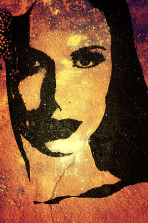 painting wall: old rustic orange wall with a graffiti illustration of a womans face. Stock Photo