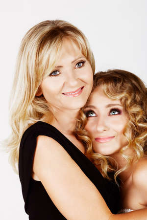 beautiful real couple mother in her 40s and teenage daughter wearing evening wear and make-up in studio Stock Photo - 8867224