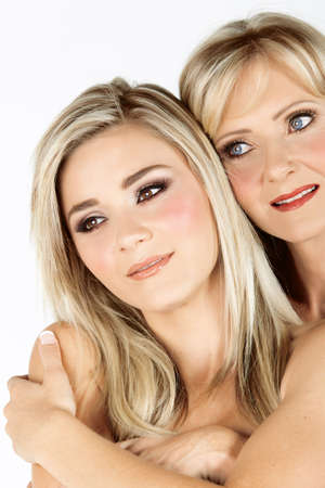 beautiful real couple mother in her 40s and gorwn-up daughter with professional make-up: faces close-up, not isolated Stock Photo - 8867221
