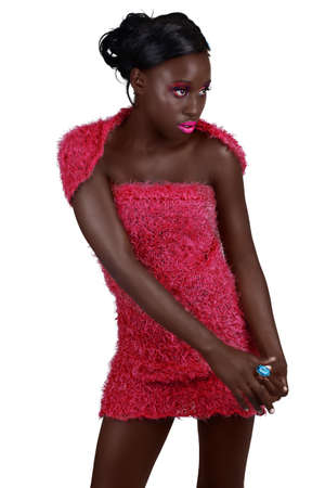 beautiful African woman with long hair in a bright pink mini dress showing her legs .and fit arms, wearing bright pink make-up Stock Photo - 8867214
