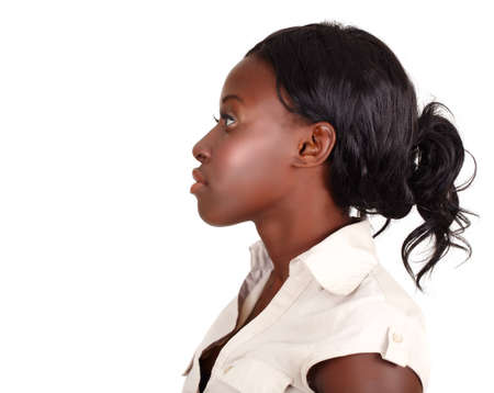 young African American businesswoman wearing light shirt looking in profile isolated on white with copy cpace