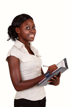 young smiling African American businesswoman wearing light shirt with a diary Stock Photo - 8867540