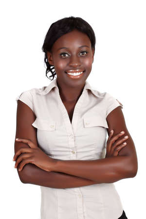 young smiling African American businesswoman wearing light shirt looking with crossed arms Banque d'images