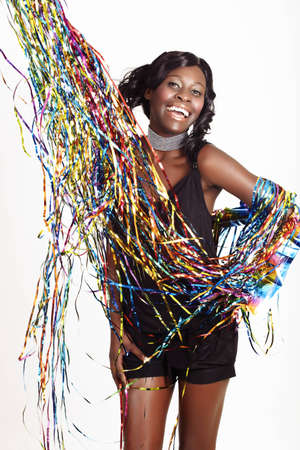 beautiful African American model in short playsuit laughing with streamers on white background - not isolated Stock Photo - 8867814