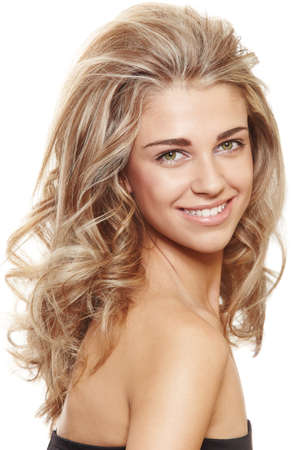 beautiful natural make-up woman with blond long hair in big hairstyle smiling at camera isolated on white Stock Photo