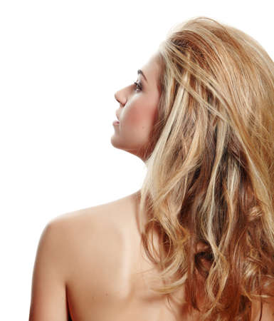 beautiful natural make-up woman with blond long hair in big hairstyle from the back looking up in profile isolated on white Stock Photo - 9156571
