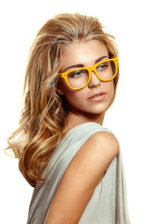 beautiful young woman with big blond long hair wearing yellow acetate frame glasses on white background. Stock Photo - 9156638
