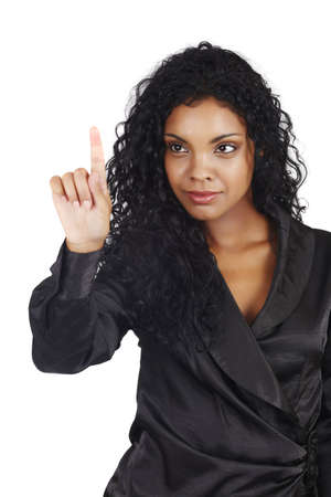 beautiful African American businesswoman with long curly hair pointing or pressing over white background. photo