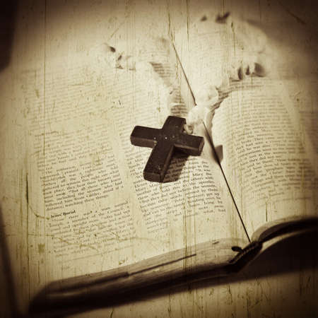 Open Bible with a cross Stock Photo