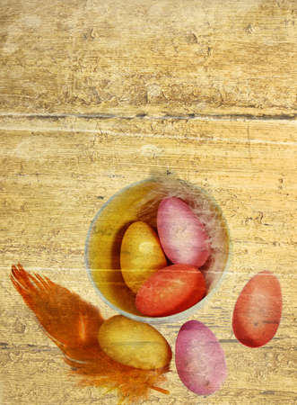 bright candy Easter eggs and feathers on painted grunge wooden background . photo