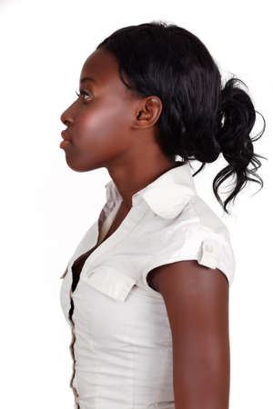 young African American businesswoman with long hair in profile on white background Banque d'images