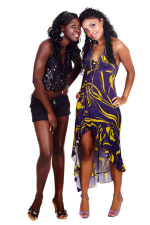 two happy African American beautiful girl friends in party dress and shorts isolated on white background
