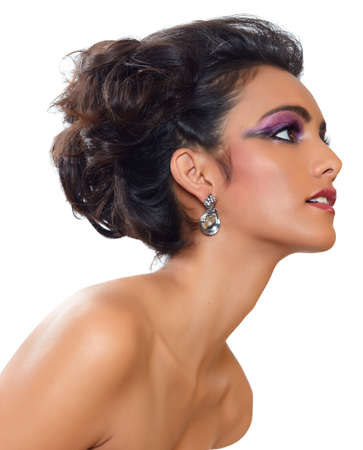 beautiful woman with dark tanned skin and long black hair in fashion hairstyle and earrings. Stock Photo - 9250616
