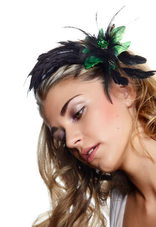 beautiful blond woman wearing green and black feather hair flower curly hair. photo