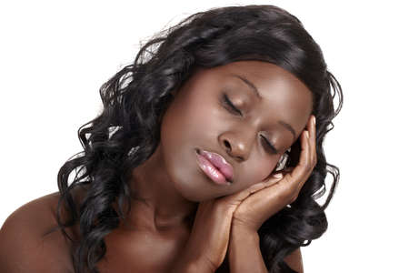 south african: beautiful African American young woman with long curly hair with her eyes closed resting on hands - easy to extend background for copy space over white. Stock Photo