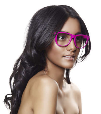 beautiful indian girl face: beautiful tanned woman with long curly hair wearing pink glasses Stock Photo