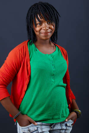 casual beautiful African woman in a green top smiling with confidence, natural make-up and good skin Stock Photo - 9594716