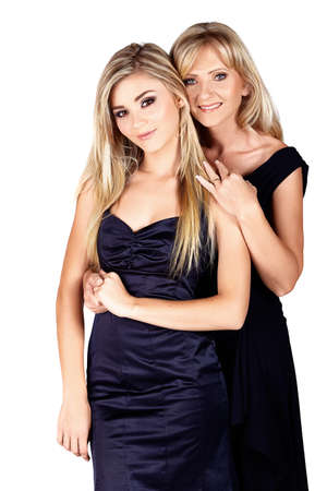grown ups: beautiful mother and daughter with make-up and long blond hair happy together on a white studio background