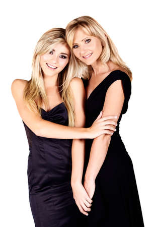 beautiful mother and daughter with make-up and long blond hair happy together on a white studio background