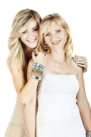 blonde mom: beautiful mother and daughter with make-up and long blond hair happy together on a white studio background