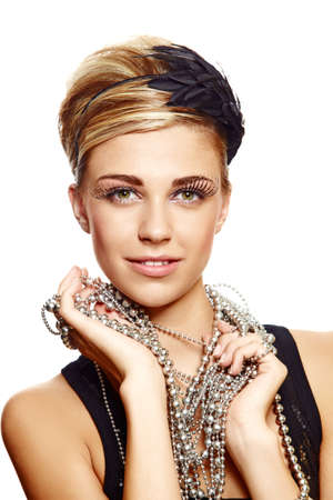 beautiful young girl with fresh make-up wearing vintage feather hair accessories and silver necklace, naturally beautiful skin texture. Banque d'images
