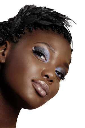 plait: beautiful young African woman portrait wearing feather headband and dark smoky eyeshadow over white background.