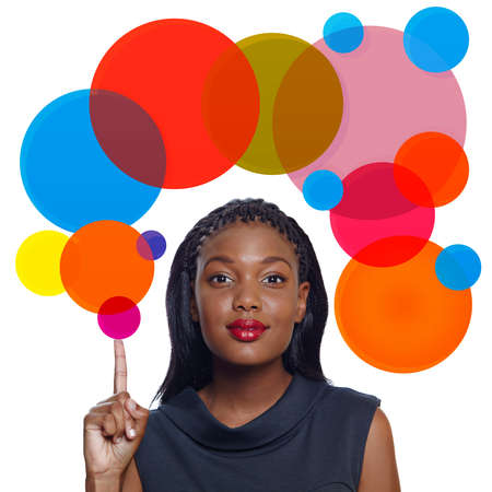 Portrait of a happy African American business woman pointing up with a smile on white background with thought bubble photo