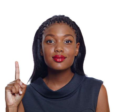 Portrait d'une femme heureuse d'affaires afro-américain pointant vers le haut avec un sourire sur fond blanc Banque d'images - 10012256