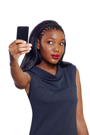 African American business woman doing self-portrait photography with a cellphone on white background photo