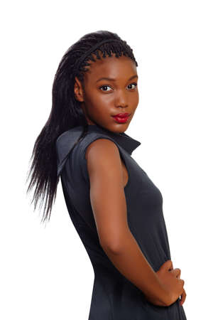 African American business woman stands confident with arms on her side and looking over her shoulder on white background photo