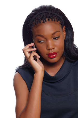 calling on phone: African American business woman listens seriously on the cellphone over white background