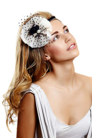 young woman portrait wearing beautiful vintage wedding headband on  long curly hair and smiling over her shoulder photo