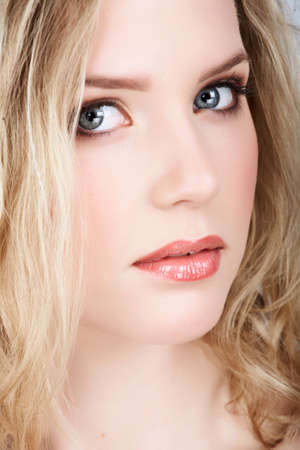 closeup portrait of young beautiful blonde woman with long curly hair and natural fresh make-up Stock Photo - 10136393
