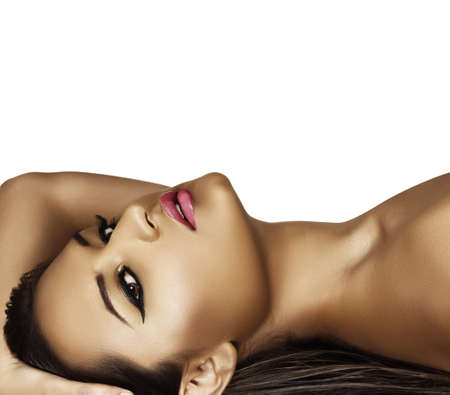 make up face: beautiful latin model with tan with fresh summer fashion make-up and dark liner on her eyes lying on her long wet hair .