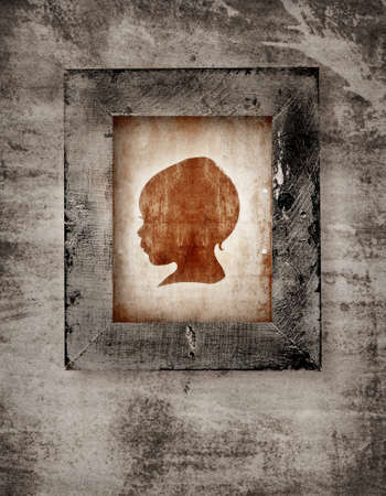 drawing of a baby face in old-fashioned silhouette style in a frame on grunge background photo