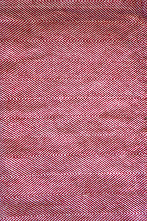 red cotton background with natural texture. photo