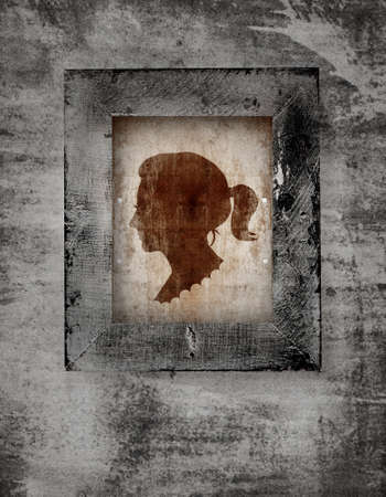 drawing of a woman face in old-fashioned silhouette style in a frame on grunge background photo