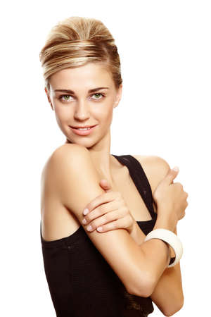 Beautiful blond woman with natural make-up wearing hair in a classic french roll updo hairstyle  over white studio background . Stock Photo - 10442067