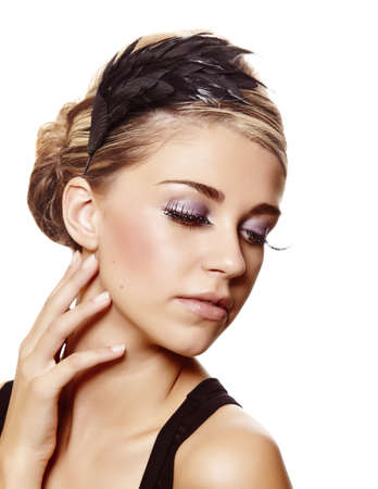 beautiful blond woman with long diamond false eyelashes and party hairstyle touching ehr neck over white background photo