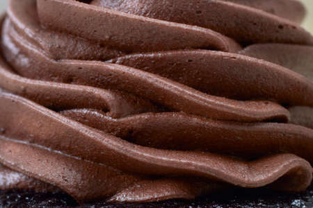butter icing: Chocolate cream layered mousse close-up Stock Photo