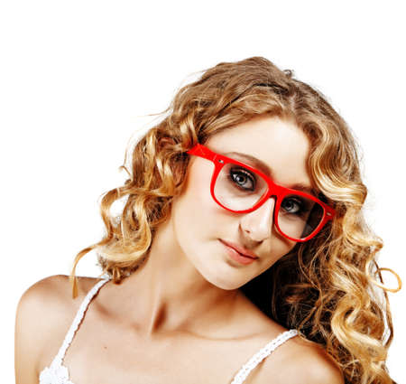 young beautiful woman with long curly hear wearing red glasses in stylish retro fashion on white background.