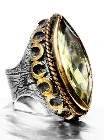 antique jewelry: gold and silver vintage style ring with large quartz stone in Ottoman style  with beautiful handmade texture. Stock Photo