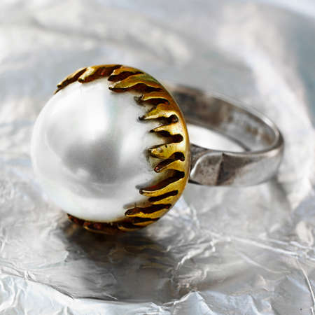 artistic hand made ring with pearl, gold and silver in Ottoman style and vintage texture. Stock Photo - 10811793