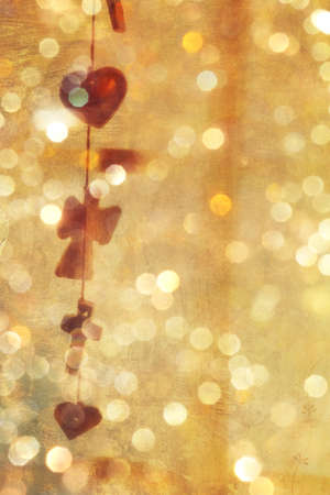 empty background with grunge texture and vintage garland of hearts and crosses with sparkling bokeh lights. Stock Photo - 11587390