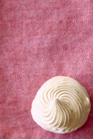 Tasty white meringue on a pink napkin with copy space. Stock Photo - 11587387