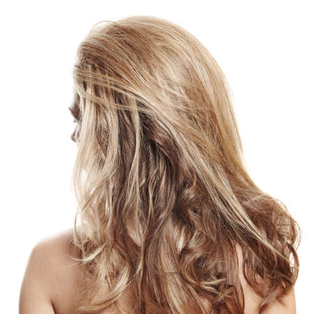 long healthy loose blond hair styled with volume - view from the back on white background photo